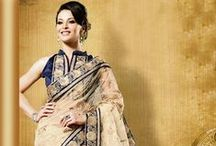Party Wear Sarees Online / Spruce up any occasion with these glittering and glamorous party wear sarees in vivacious colors and textures. Dipped in bright palette and accentuating opulent embellishments, these party wear sarees will get you the 'from where did you got this' appeal.