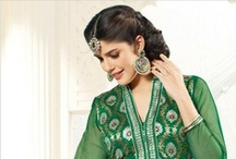 Green Dresses / There's something fresh, appealing and eternal about green. No wonder we have a special array of green dresses for every lover of the color. Our green dresses come in shades ranging from light pista to bright parrot and every hue in between.  How about a net jacquard Anarkali, a green velvet saree or a cool cotton salwar kameez? If sheer fabrics like Chanderi and Net appeal to you, our range will steal your heart. So discover the magic of green, today!