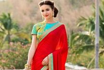 Latest Designer Sarees Online / Latest designer saree collection is available at Utsav Fashion for shopping. Buy exclusive designer sarees online in a wide variety of fabrics and shades.