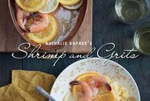 Charleston Cookbooks / Want to experience the heart and soul of Charleston, South Carolina? Taste the cuisine. Benne wafers. Carolina Gold rice. Oyster stew. Pickled okra. She Crab soup. Shrimp and grits. Charleston's Lowcountry cuisine is comprised of heirloom recipes proudly passed from one generation to the next over the past 300+ years, and it is uniquely seasoned by Gullah influence, the Charleston area's native sea island culture with a distinctive language, legends, crafts, and cuisine.