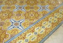 Cement Tile Borders / One of the classic ways to lay cement tiles is to create a rug like effect with a border tile surrounding a field tile. A beautiful border on an encaustic cement tile floor takes a little more planning but the effect is well worth it.
