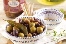 Spanish Olives / Our selections are firm and flavorful, some cured with garlic and herbs, and others hand-stuffed in Spain.