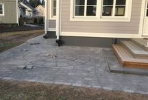 Paver Patio Design / Build of Benders Orion Ring Maxi and Benders Labyrint/Troja Antik Graphite 210x140mm. The other side of paving stones are Labyrint and other side is Troja. We have used Troja as front and Labyrint for borders. Flower bed wall and part of the landcape borders are Labyrint Maxi Graphite 350x210x140mm. Stairs are Benders Blocks Graphite 1050x350x150mm and every second is 700x350x150mm.