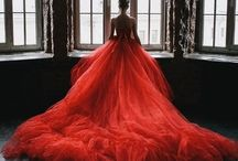 Dame en rouge / A woman's dress should be like a barbed-wire fence,serving it's purpose without obstructing the view. Lady in Red.