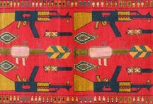 War Rugs / Women from Afghanistan's Baluchi culture began to weave the violence they encountered in their daily lives into rugs, soon after the arrival of the Soviets 1979, At first the aggressive imagery was rather hidden. Brokers and merchants refused to buy war rugs with overt designs for fear they would put off buyers.  With the rugs' increasing popularity, the images became so prominent that one can even distinguish particular guns, such as AK-47s, Kalashnikov rifles, and automatic pistols.