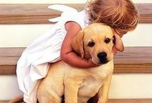 Doggone cute! / What's cuter than a baby?  A baby and it's pet!