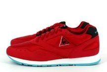 LE COQ SPORTIF FLASH X 24 KILATES / Le coq sportif & 24 Kilates - sneaker reference in Barcelona present an electrical version of the Flash, retro running style from le coq sportif 90's archives. Mix of a shiny blazing red mesh and black and red nubuck, light blue exterior sole, co-branded logo on the tongue and two pairs of insoles.