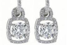 """Clarity Enhanced Diamonds - Fancy for Less / Clarity enhanced diamonds undergo a special """"touch up"""" procedure that allows more light to enter the diamond and consequently results in an even more brilliant sparkle. Affordability is just one more reason to say """"I do"""" to clarity enhanced diamond rings. These diamonds are typically purchased for ⅓ less than the carat price of comparable, non enhanced diamond."""