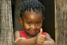 """Children around the world / """"Children are the hands by which we take hold of heaven.""""              Henry Ward Beecher"""