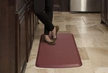 Stand in Comfort / GelPro 100% gel-filled comfort floor mats are ergonomically designed to provide superior comfort for your feet, legs and back while standing on hard flooring.