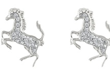 DAMIANI FOR FERRARI / Damiani created an exclusive jewellery collection for men and women, inspired by Ferrari and its prancing horse. Ferrari jewels are available on store.ferrari.com. Order them online and wear the Ferrari legend.