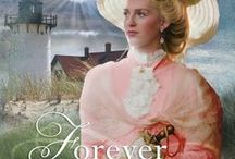 Novel: Forever Safe / Northern Lights Press, June, 2016: Heiress to a vast fortune, Victoria Cole has everything she wants, including the perfect fiancé. Having left  two other men at the altar, Victoria is sure that now she's found her true love and will finally live happily ever after. As her wedding draws near, however, Victoria's life is threatened. To keep her safe, Victoria's father hires a bodyguard.