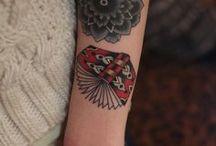 tattoos :) / by Dollie Gott