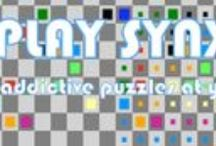 Synx / The aim of the game is to join like coloured squares. Simple enough a puzzle, or so it sounds. Click on a coloured square and drag the mouse along, leaving a trail. When you reach the square's partner, let go to make the trail official. Two paths for different coloured squares cannot cross, except on a whirlwind square (in the second set of puzzles.) Beat the game by joining up all the pairs of coloured squares and completing all the puzzles!