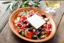 Greek Salad! / Greek salad is a summer salad dish made with pieces of tomatoes, sliced cucumbers, green bell peppers, onion, sliced or cubed feta cheese, and olives (usually Kalamata olives, other types of olives may be used as well), typically seasoned with salt and dried oregano, and dressed with olive oil. Common additions include the pickled leaves, buds or berries of capers (especially in the islands of the Dodecanese), rocket leaves, vinegar, lemon juice, and chopped parsley.