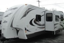 Cougar X-lite Travel Trailers / With Xlite by Cougar you no longer have to sacrifice good taste when buying a lightweight travel trailer.  Xlite shares your vision of beauty, elegance and towability with kitchens that really cook, magnificent master suites, full-sized slide outs, and bunkhouse models that can sleep up to nine people / by Petes RvCenter