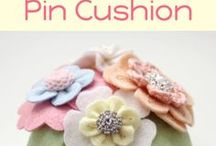 Pin And Needle Keeps #1 / Pin cushions and needle books.  Works of art!