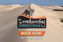 Sandboarding Sunday's River / Sandboarding @ Sunday's River is only 5 km from the famous Addo Elephant National Park. Sandboarding Sunday's River has all the latest sandboards and we provide lessons for those who are new to the sport. If this is your first time sandboarding don't stress :) its easy and it's great for learning how to snowboard as it is a bit slower in the sand. Sandboarding is great FUN for the whole family and is perfect for ages from 3 - 101.  LIFE'S SHORT CATCH A TAN  ; ).