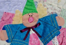 Quilter / My baby crib size quilts will be perfect gift for any baby shower.  Children will love cuddling in their cheerful quilts with whimsical applique pictures floating across the field of patchwork.  I have lap size quilts for anyone looking for a quilt with a twist.  A wonderful gift for all ages!