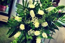 In House Memorial Designs / Sympathy bouquets, standing sprays and casket saddles.