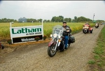 "4th Annual Freedom Ride / Come early and join our company's 65th anniversary in Alexander, IA, with a series of keynote speakers & in-field presentations. Tour our seed production facilities, & see first-hand why Latham Hi-Tech Soybeans are ""quality in the bag."" You'll learn about seed technologies in the pipeline, plus we'll have a lot of fun along the way. Enjoy a scenic drive around Clear Lake & a special behind-the-scenes tour of Hagie Manufacturing in Clarion."