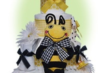 Baby Shower Centerpieces / The best selection of baby shower centerpieces, diaper cakes and baby shower gifts in many styles. Great gift ideas for new baby and delight the new parents. / by Lil' Baby Cakes