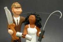 interracial and mixed race wedding cake toppers / Wedding cake toppers custom made for interracial and mixed race weddings....  ...bride and groom can be in gown and suit or in a casual look...whatever details you want to incorporate into the figurine is possible.... get some inspiration from these examples   created specifically for weddings involving brides and grooms who are Hispanic, Oriental, African American, Caucasian and any combination under the sun :-)  www.magicmud.com 1 800 231 9814
