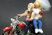 "Motorcycle Wedding Cake Toppers / custom made wedding cake toppers created for Honda, Suzuki, Kawasaki, Harley, Triumph, Ducati, BMW or any other motorcycle riders!!... got a Vespa.??!..sure, hop on!!,,,  we are equal opportunity bike riding sculptors :-)  ..likewise bride and groom can be in gown and suit or down n dirty in their leathers and sunglasses for that  ""cool biker"" look... or any variation ... all is made to your wishes!  www.magicmud.com     1 800 231 9814"