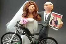 Bicycle Wedding Cake Toppers / Bicycle Wedding Cake Toppers by www.magicmud.com custom made for bicycle riding bride and grooms...be it mountain bikes, road bikes, triathlon bicycles...whatever style!..they are all handmade to clients specifications by the Vaughan Family, over 35 years in operation, creating personalized wedding cake toppers and custom made figurines of all kinds! Its totally easy to just call us at 1 800 231 9814 and design your biker's cake topper over the phone.