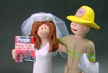 "Fireman and Firefighters Wedding Cake Toppers / Fireman's Wedding Cake Toppers custom made to clients specifications....if you know a fireman that is about to wed what could be a more perfect keepsake!!?... these clay figurines are hand sculpted with the groom in suit or fireman's coat and hat, or any combination of those, with axe or hose....or whatever you want....let us portray the special ""hero"" and his bride in just the right scenario.... www.magicmud.com    1 800 231 9814"