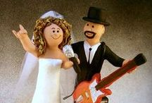 "Guitarist's Wedding Cake Toppers / Guitar Players Wedding Cake Toppers....made to order figurines featuring the guitar player in your life... personalized to the client's desire...the ultimate wedding cake topper for guitarists of all styles, be they pop stars,rock n rollers, heavy metal players, folk players....whatever style of music doesn't matter!... totally rock the wedding with the ultimate matrimonial keepsake...perfect for the ""rock god"" in your life! www.magicmud.com      1 800 231 9814"