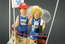 Marathon Runners Wedding Cake Toppers /   Marathon Runner's Wedding Cake Toppers   Wedding Cake Toppers for Joggers, these ceramic figurines are custom hand made for brides and groom who love running marathons, triathlons, or any type of jog or run.  The wedding couple can be in gown and suit, in shorts and singlet, or any combination of clothing...they are all sculpted to the client's specifications.. www.magicmud.com 1800 231 9814