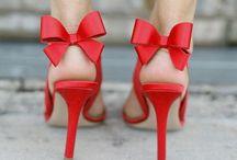 Head Over Heels / Heels. Stilettos. Boots. Nikes. All things footwear.  / by Kathryn Powell