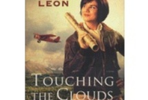 A book about a woman, a plane and Alaska - TOUCHING THE CLOUDS / The story of a pilot named Kate who dared to make a new life for herself in the Alaska territory, 1935.
