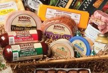 Gift Assortments / Burgers' Smokehouse carries a variety of gourmet food gifts and online gift baskets.  No matter what the occasion or budget, you'll find gourmet food gifts to please.  Try a Smokehouse Delight or Sausage and Cheese Gift box. You can order gourmet gifts online or send a food gift certificate.