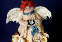 Cake Angels/Cupid / novelty cakes basked on angels and cupids