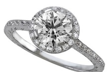 Halo Style Engagement Rings / by WEDDINGRINGS.COM