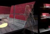 """Sarcofaghi Monumentali / Il progetto tenta di coniugare due istanze, quella monumentale/commemorativa e quella culturale/conoscitiva. Il progetto si pone con un atteggiamento di rispettoso silenzio azzerando il livello di complessità fino al grado essenziale della forma: i due sarcofaghi sono pensati come due organismi semplici, prismatici, leggermente """"deformati"""" a formare delle superfici rigate."""