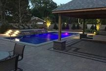 Water Oasis / Water Features provide a visibly beautiful effect to any landscape and offers a tranquil setting to any garden. The relaxing sound of water flowing in the landscape creates a positive rejuvenating environment. Each waterfall crafted is unique to fit your individual desires; from the pump size, location, height, surrounding landscape, pool-side, noise level, lighting, & planting. With the experience of building many water features before, we ensure a beautiful outcome to our clients.