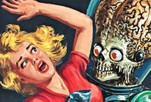 """Mars Attacks  / """"Mars Attacks is a science fiction trading card series released in 1962. The cards feature artwork by science-fiction artist Wallace Wood and tell the story of the invasion of Earth by cruel, hideous Martians. The cards depicted futuristic battle scenes and bizarre methods of Martian attack, torture and slaughter."""""""