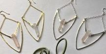 Pigeon Heart Designs Jewelry / Sterling and brass earrings, necklaces, and hairpins that are hand hammered as well as hypoallergenic, incorporating crystals, naturally shed deer antlers, and ethically salvaged coyote teeth for your adornment.