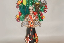 """Catrinas / """"In Mexico, one of the most significant holidays is the """"Day of the Dead"""" right after Halloween.  These figurines are known as Calaveras Catrinas, or the """"Elegant Skull."""" The Catrina figurines have become the most identifiable image of the Day of the Dead and one of Mexican culture in general."""" / by Ilda Martins"""