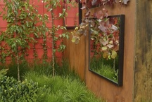 Mirrors and glass in the garden / Glass sculpture for outdoor is not very common but there's no reason you couldn't use stained glass windows, blown glass or slumped glass.  Mirrors for outside use have to be specially made and well-sealed for that purpose. You can use mirrors in several ways - to make a garden seem bigger than it really is; to reflect light into a dark, shady part of the garden; to make the mirror a 'picture on the wall'; & to create illusions.