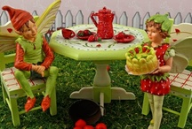 Fairies and Gnomes in the Garden / Miniature fairies and garden gnomes frolicking in our miniature fairy gardens.