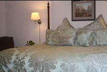 Birdfoot Violet / Bedroom with a king bed and an almost primitive color feel on the furniture.
