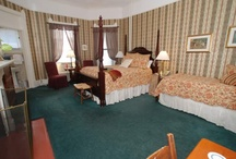 American Holly / One Hand Carved in North Carolina Queen Bed and One Twin Bed with Standard Tub and Shower Combination in Bathroom.