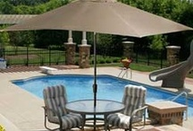 Stay Cool By The Pool / Summertime means sizzling temperatures. These accessories and additions to your swimming pool area can help you stay cool.