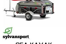 SylvanSport - Sea Kayaks / The SylvanSport GO and GO Easy are designed to carry a LOT of gear! Bring along a couple 20'+ sea kayaks, coolers, camping gear and leave your tow vehicle wide open for what's important - dogs, kids, friends and family!