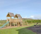Holiday cottages with play areas / Kids love playgrounds, swings, slides, roundabouts, they can be entertained for hours. We have some fantastic holiday accommodation with children's play areas both in the UK and abroad. Ideal when considering where to go on your family holiday.