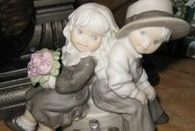 Pretty As A Picture Collection / I have a collection of Pretty as a Picture figurines.  Unfortunate that they ended production.  Precious depictions of the 1920s, 30s, 40s, to up present.   This is a tribute to my collection.  I hope I can find them all.   / by Terry Abuali